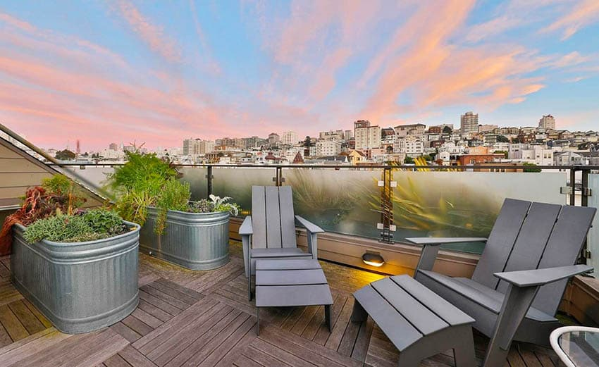 Rooftop deck with wood tiles galvanized tub garden planters