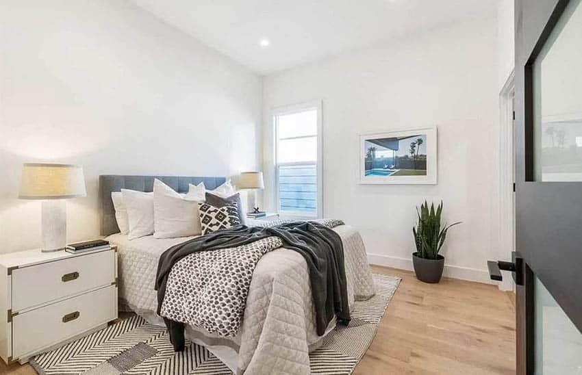 Scandinavian style bedroom with wood flooring