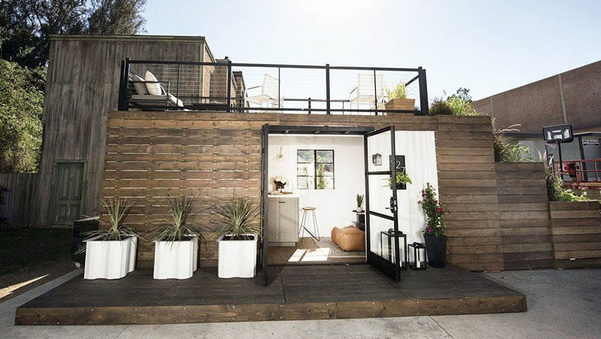 Shipping container with rooftop deck