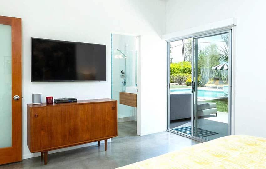 Sliding door connecting bedroom to outdoor living