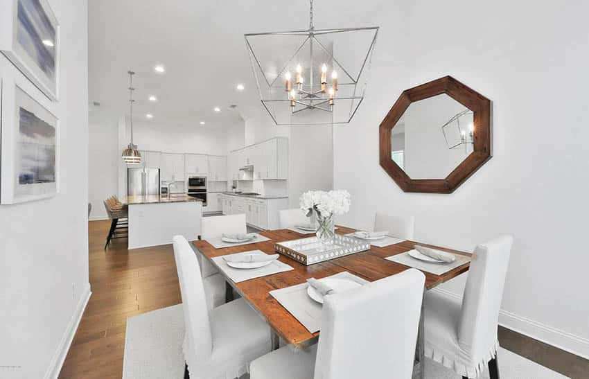 Staged dining room with wood table and chandelier