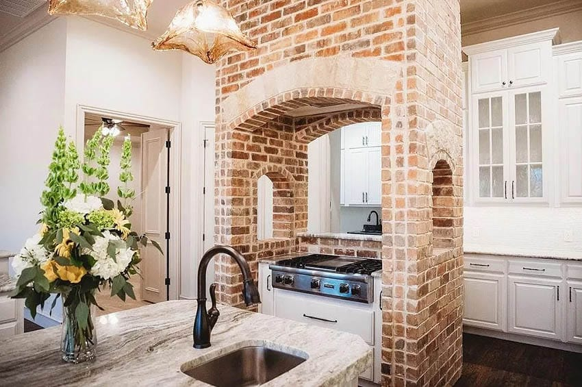 Traditional kitchen with custom brick island oven hood