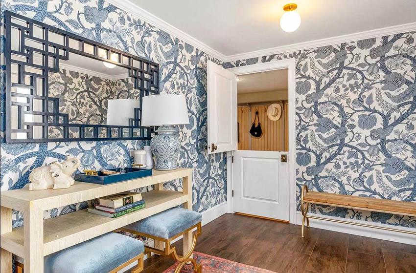 White interior dutch door opening to wallpapered bedroom