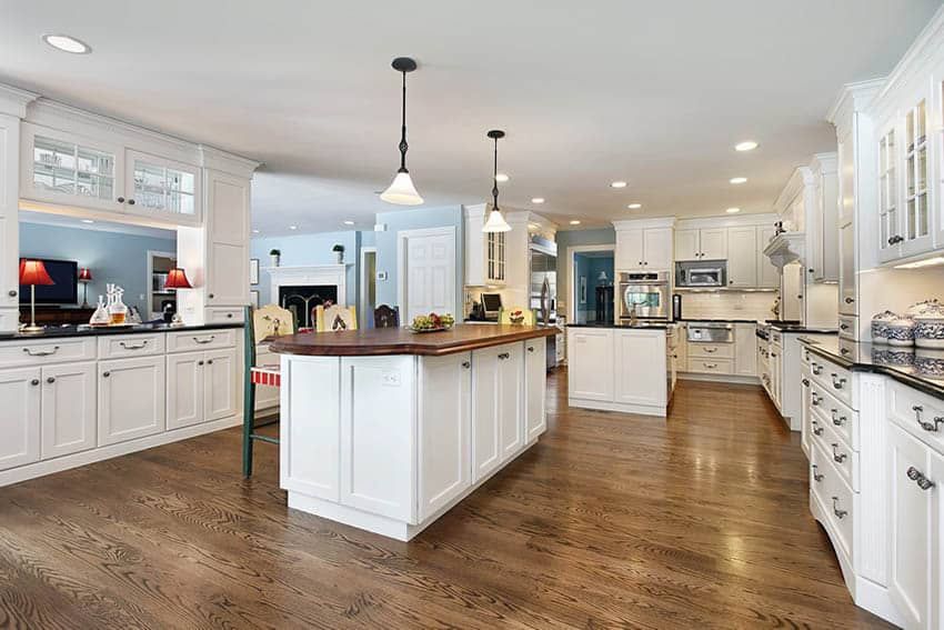 White shaker cabinet kitchen with two islands