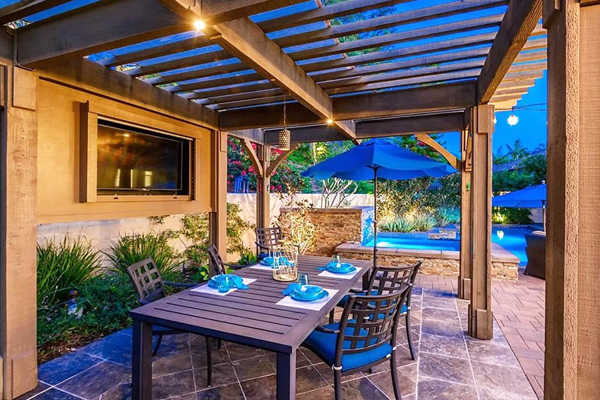 Backyard pergola with outdoor dining table wall mounted tv
