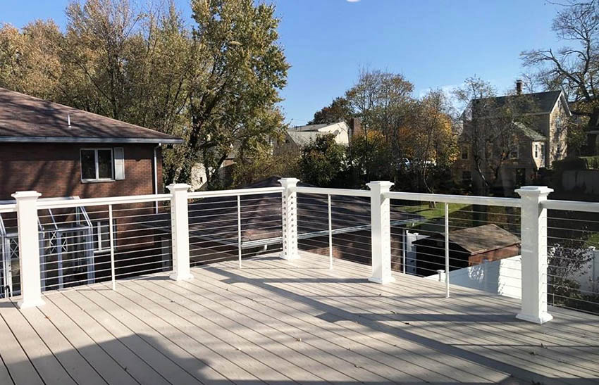 Cable deck railing with painted white posts