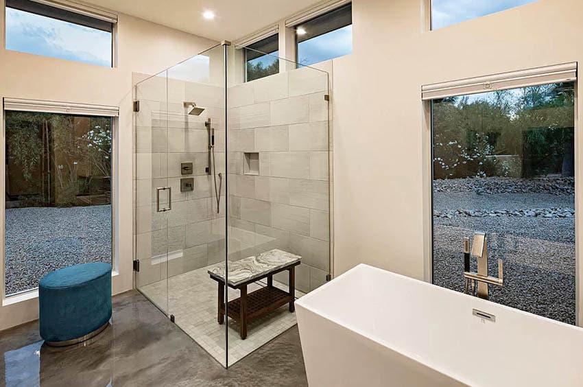 Contemporary bathroom with clerestory windows walk in shower concrete flooring