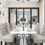 Contempoary dining room with white table, gray chairs and black area rug