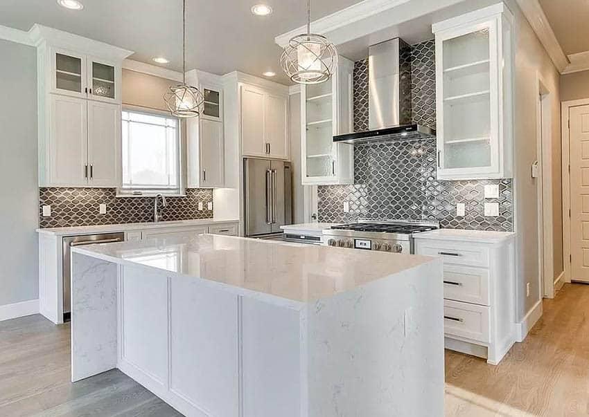 Contemporary kitchen with cambria quartz countertops white cabinets gray tile backsplash