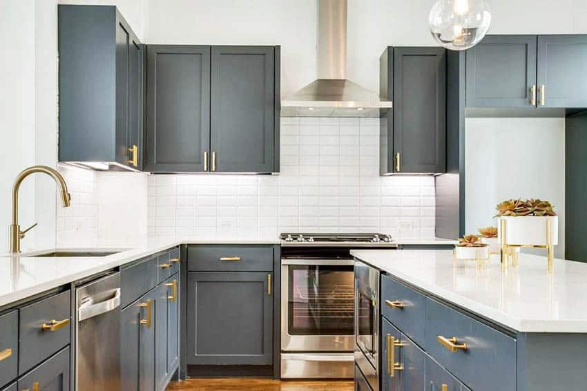 Contemporary kitchen with dark gray cabinets gold cabinet hardware white quartz countertops