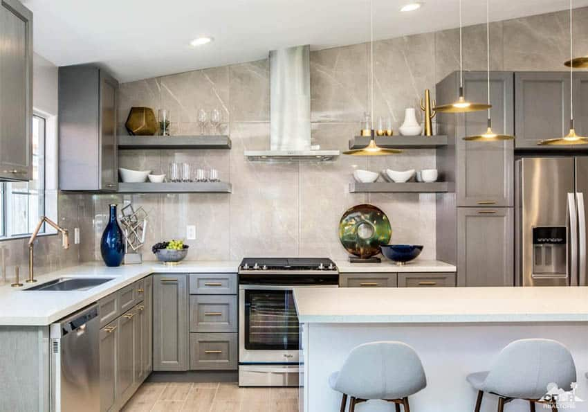 Contemporary kitchen with dark gray cabinets, gold hardware and glass luminaires