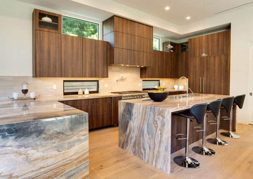 Contemporary kitchen with quartz countertop island and peninsula dark wood cabinets light wood flooring