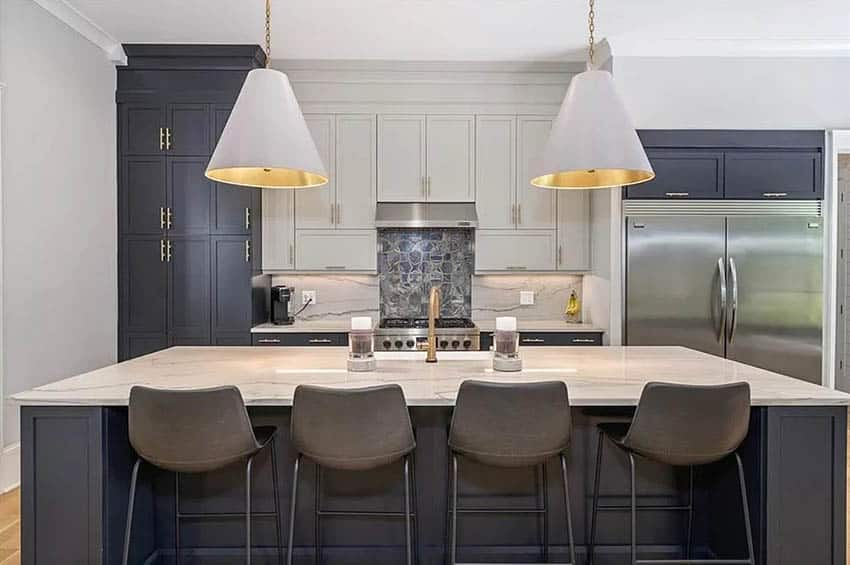Contemporary kitchen with quartzite countertops and dark blue cabinets with white center cabinets