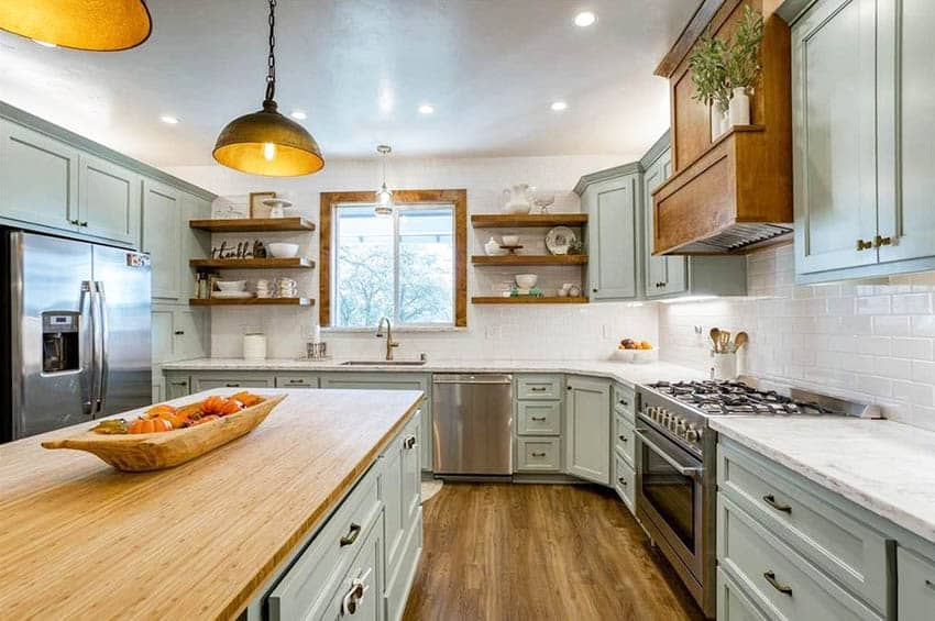Country kitchen with bamboo countertop island and light green cabinets