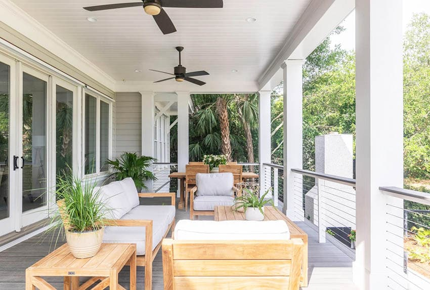 Covered deck with modern cable deck railing