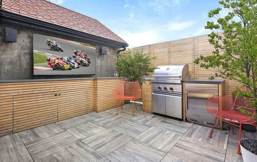 Deck with wall mounted outdoor tv and barbecue