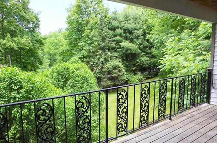 Decorative wrought iron deck railing