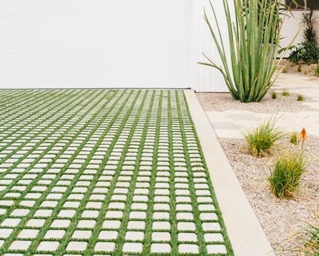 Grass and paver brick driveway
