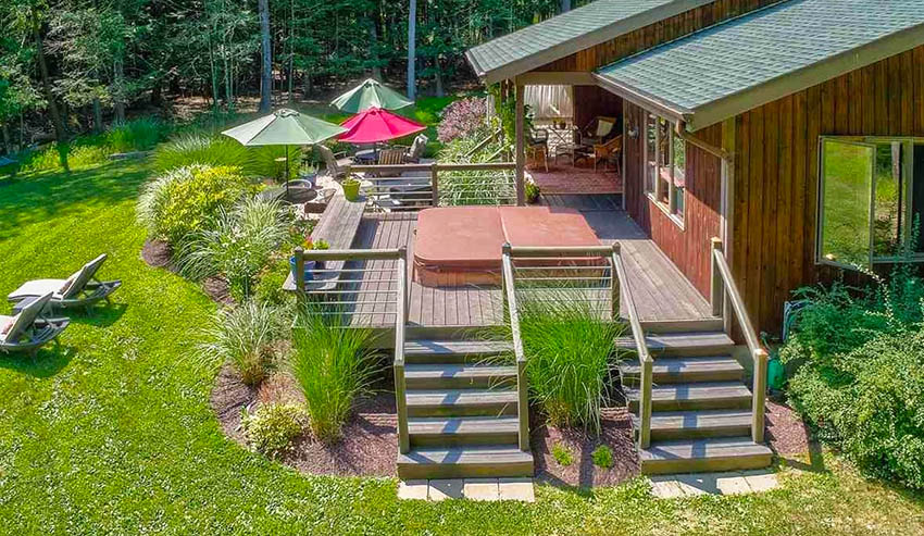 Hot tub deck with stairs and hand rails