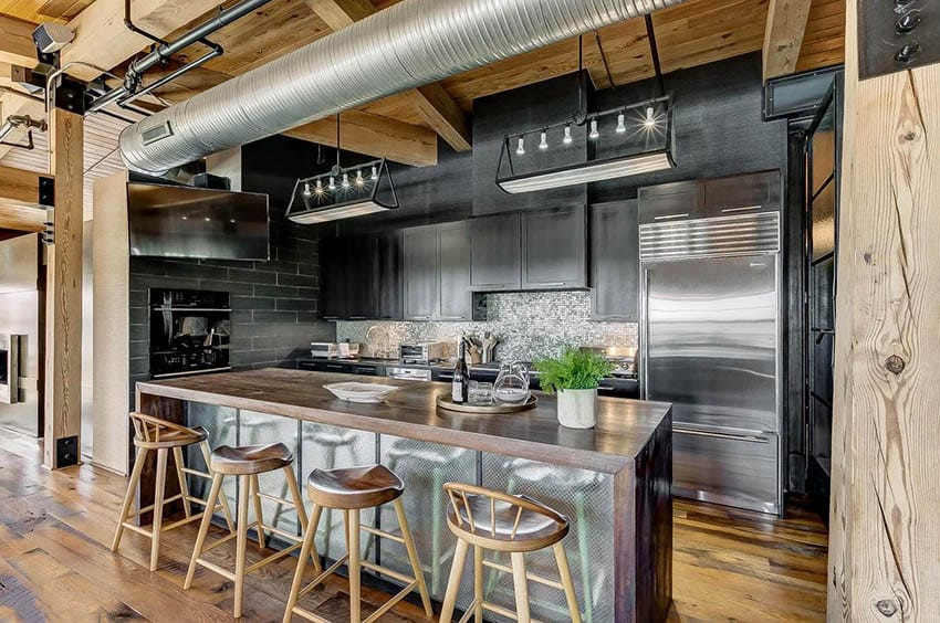 Industrial style kitchen with reclaimed wood countertop island black cabinets open duct work