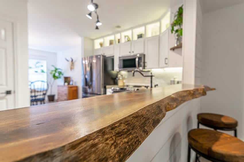 Kitchen breakfast bar with live edge reclaimed wood countertop