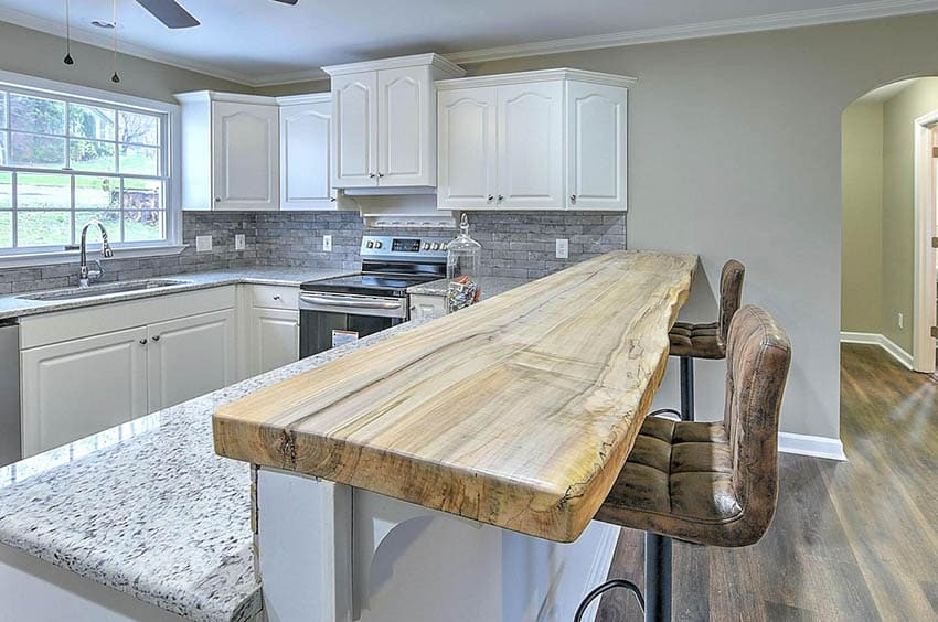 Kitchen breakfast bar with live edge wood countertops
