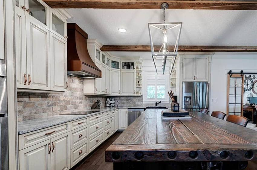 Kitchen with antique reclaimed wood countertop island white cabinets