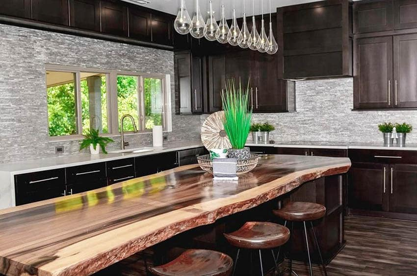 Kitchen with custom rainbow poplar mineral stained live edge wood countertop