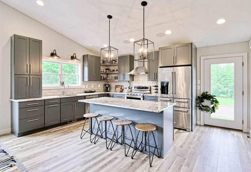 Kitchen with dark gray cabinets and light gray island white granite countertops