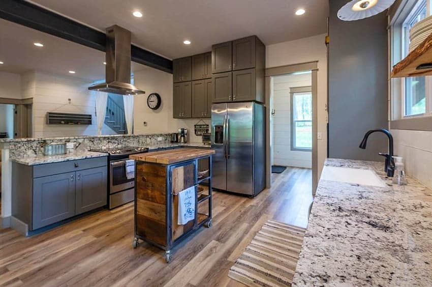 Kitchen with dark gray cabinets breakfast bar peninsula and portable rolling island
