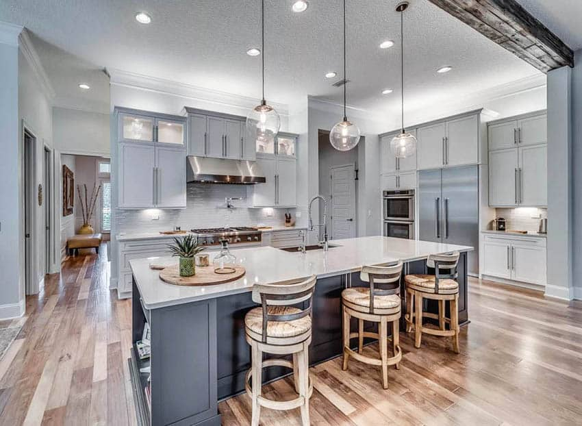 Kitchen with dark gray island and light gray cabinets