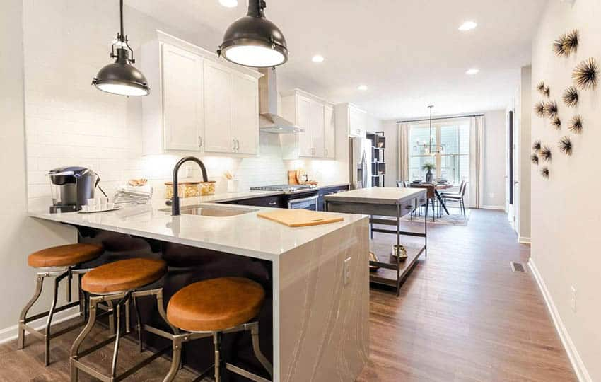 Kitchen with eat in dining peninsula cambria quartz countertops portable island