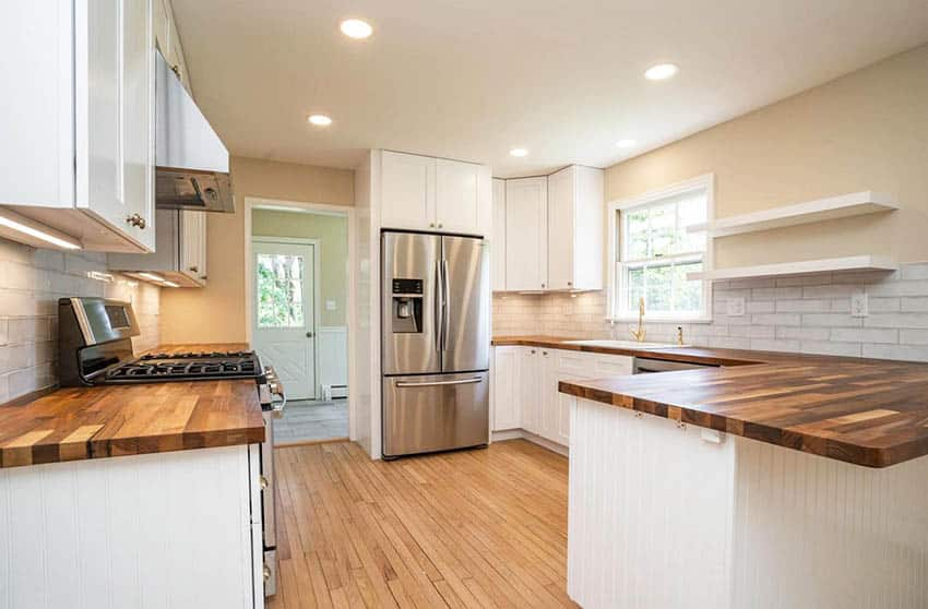 Kitchen with edge grain walnut countertops white cabinets