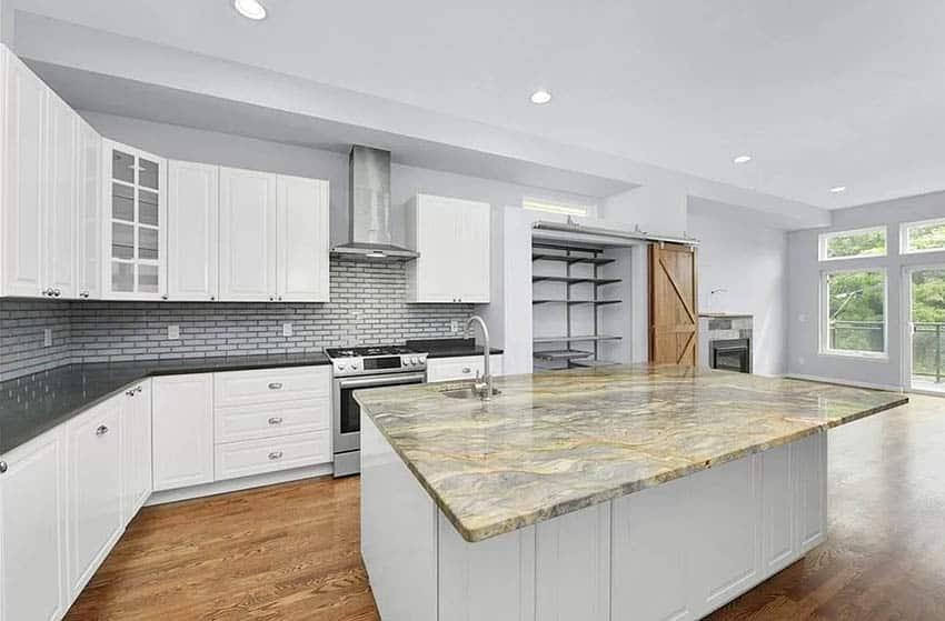 Kitchen with exotic quartzite countertop slab island black quartz countertops and white cabinets
