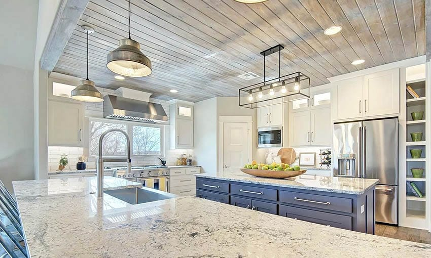 Kitchen with granite peninsula island with blue cabinet and tongue and groove wood ceiling