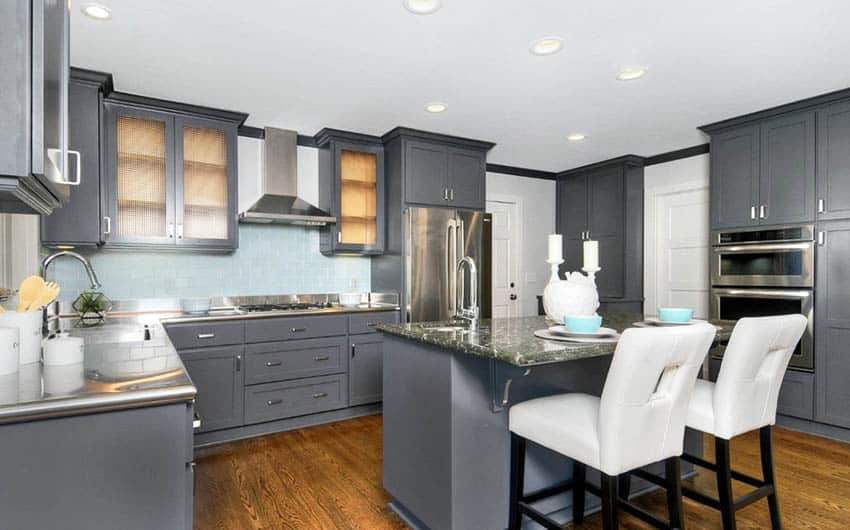 Kitchen with gray cabinets dark quartz island stainless steel countertops