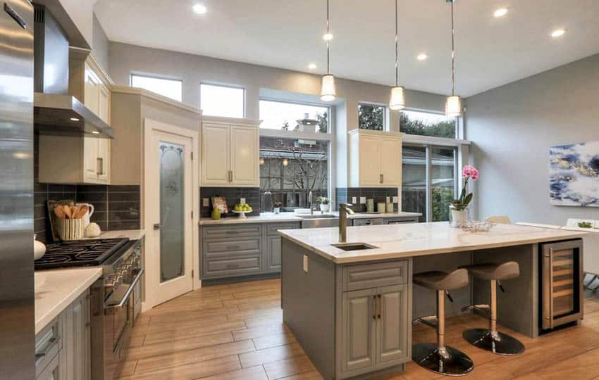 Kitchen with gray cabinets gray wall paint quartz countertops porcelain wood look floors