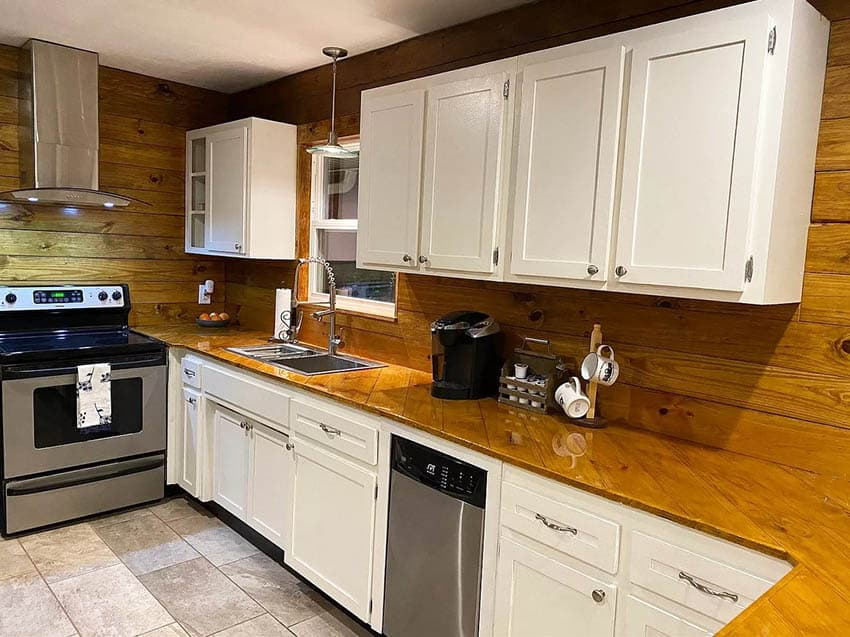 Kitchen with hardwood epoxy finished countertops white cabinets