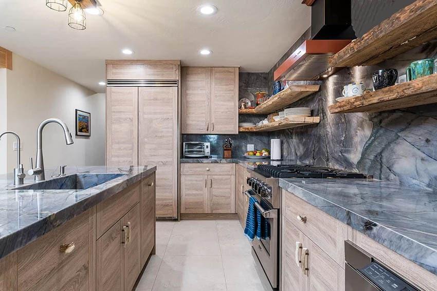 Kitchen with quartzite countertops wood veneer cabinets live edge wood open shelving