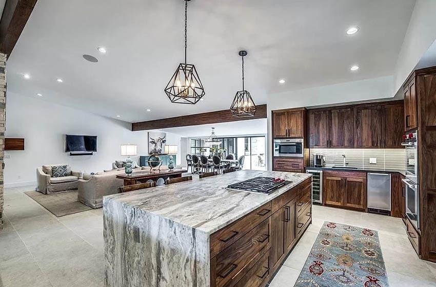 Kitchen with quartzite island solid wood cabinets travertine flooring