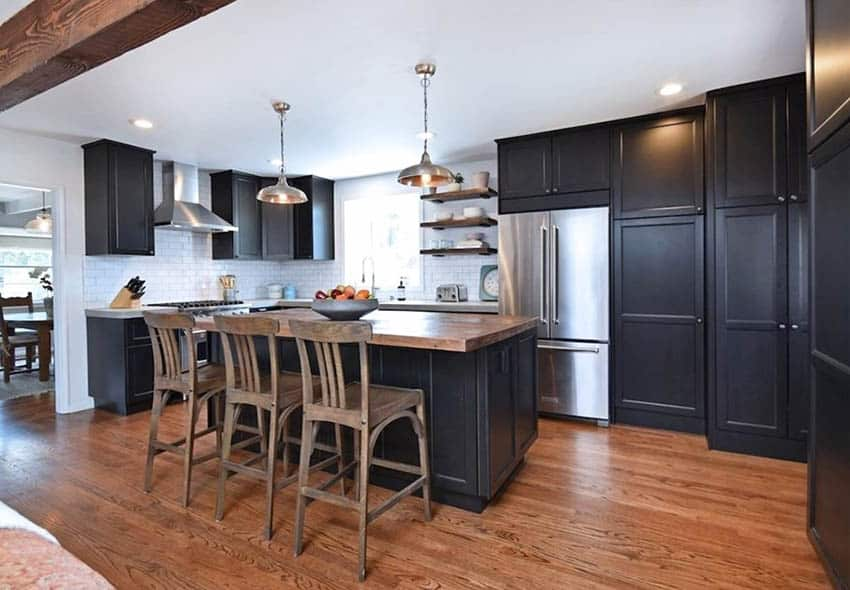Kitchen with reclaimed wood island black cabinets wood flooring