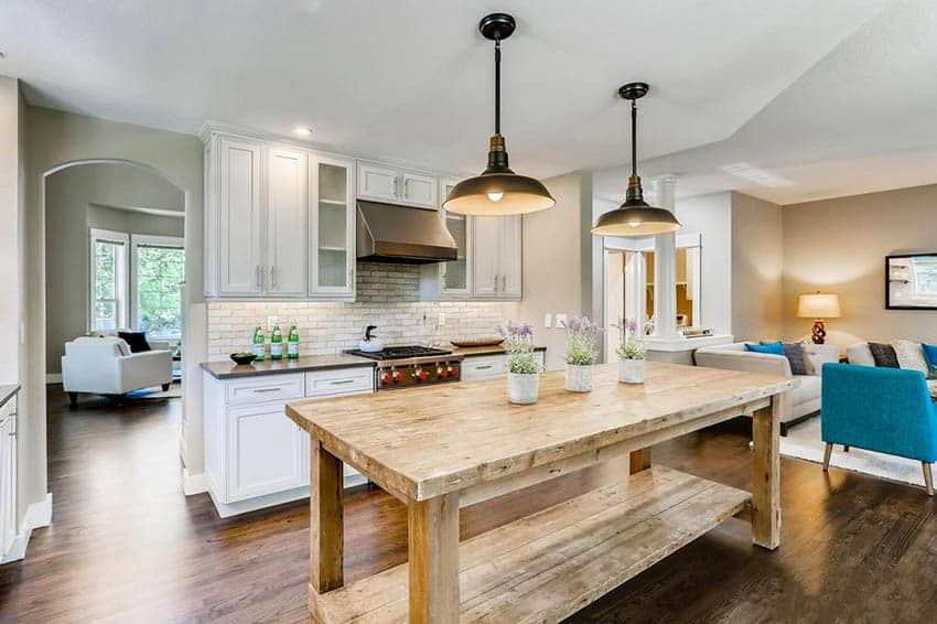 Kitchen with rustic reclaimed wood countertop table island