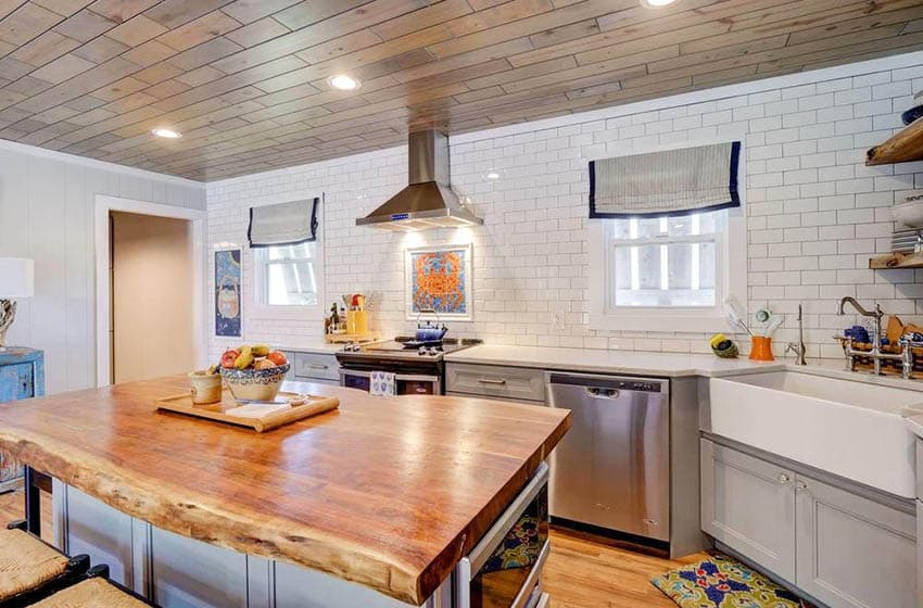 Kitchen with thick slab wood live edge countertop island and wood plank ceiling