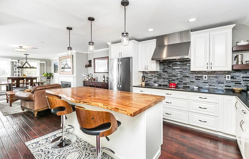 Kitchen with white cabinets and live edge wood countertops