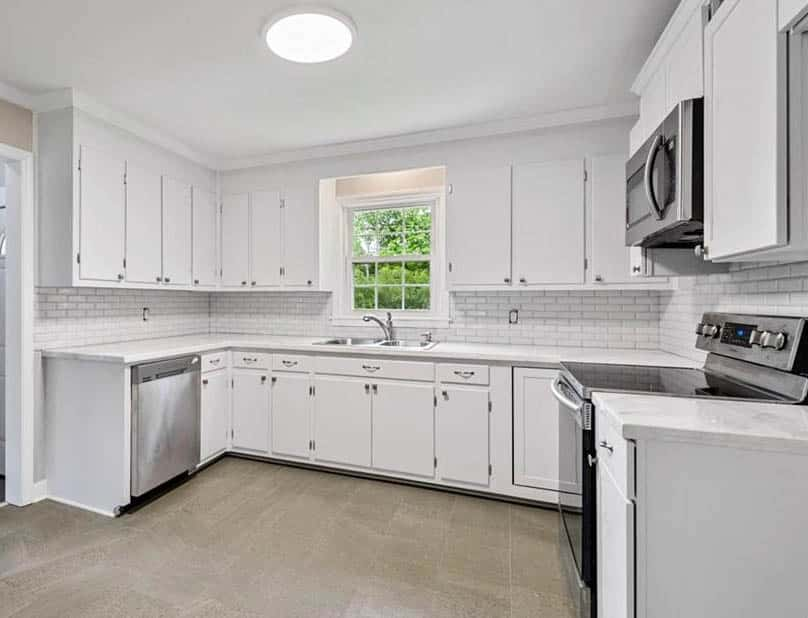 Kitchen with white epoxy countertops and cabinets