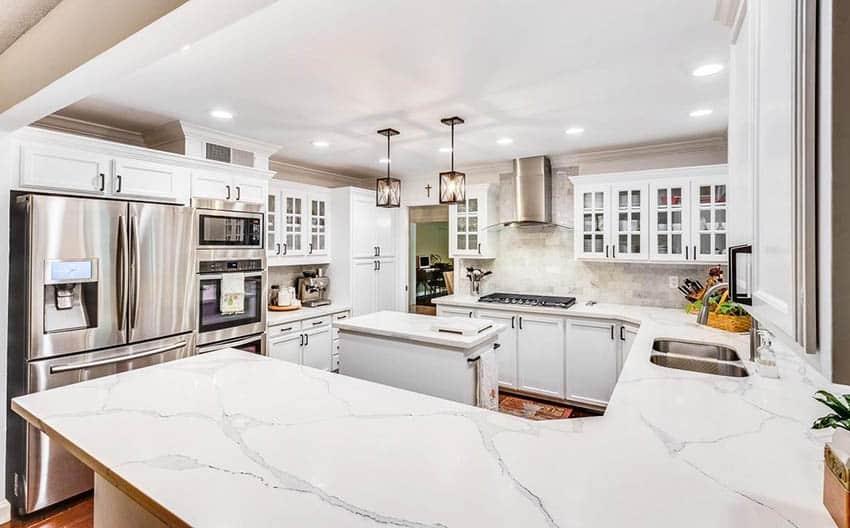 Kitchen with wrap around peninsula small island and calacatta classique quartz counters