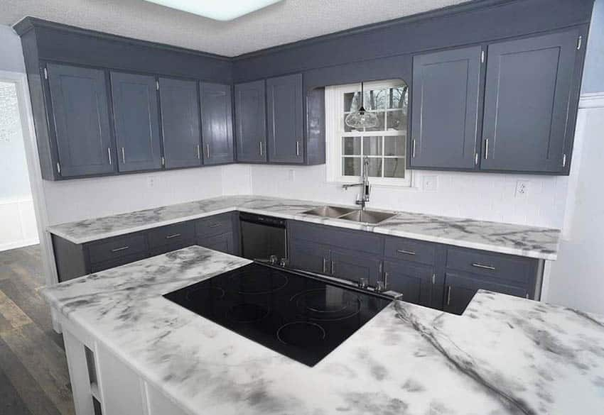 L shaped kitchen with epoxy countertops gray cabinets