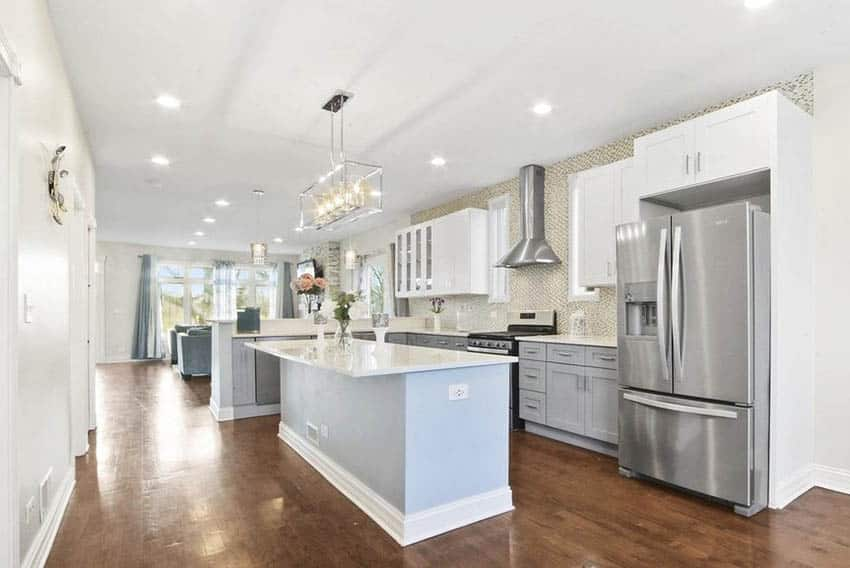 L shaped kitchen with island and peninsula gray and white cabinets