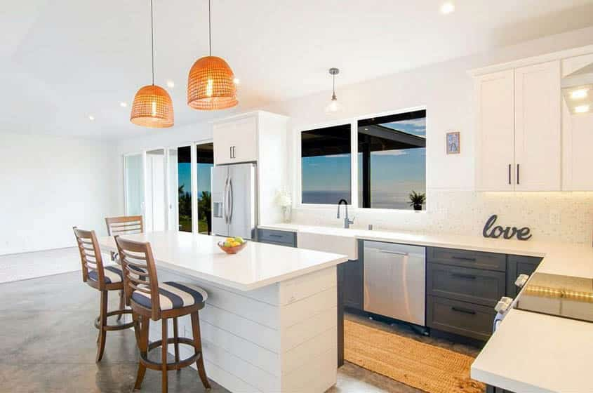 L shaped kitchen with shiplap island and peninsula with stovetop