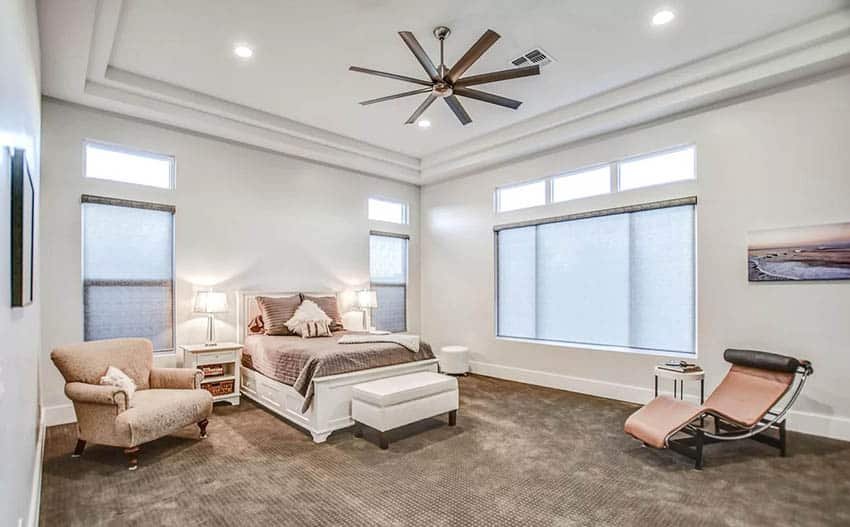 Master bedroom with clerestory windows and high ceiling